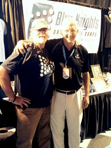 Fred Morrison, Troopers Director with Mark Arnold, Blue Knights Director, at the Blue Knights Marketplace during the 2014 DCI World Championships in Indianapolis, IN.