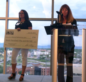 Jordan Jacobsen accepts the third place award while Colfax Marathon CEO Andrea Dowdy comments on Ascend's mission and programs.