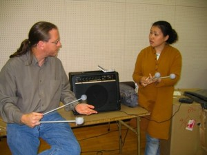 Mike Nevin teaching a student in Japan.